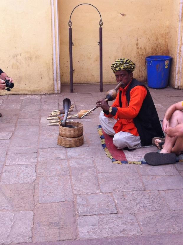 snake charmer at the City Palace Gates